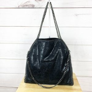 curb chain handle faux leather bag